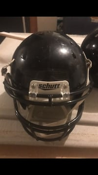 Black and gray Schutt football helmet 35 km
