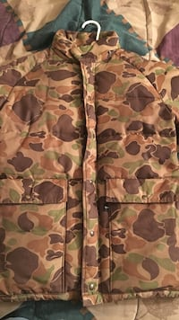 brown, green and black camouflage jacket
