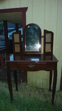 Vanity with mirror that opens into jewelry box.