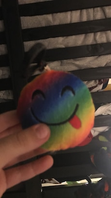 round blue, green, and yellow smiley sticking her tongue tout keychain