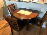 round brown wooden table with four chairs dining set Mono, L9W