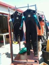 two assorted wet suits
