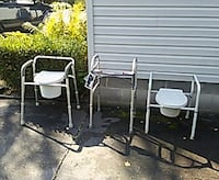 two gray-and-white commodes and a walker
