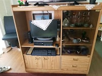 brown wooden TV hutch with flat screen television Winnipeg, R3C 2A8