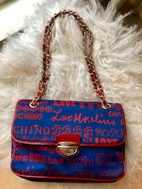 Women's blue and red leather sling bag