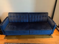 tufted gray and blue suede sofa