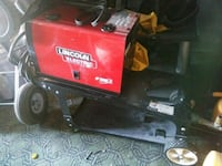red and black Lincoln Electric portable welding machine Los Angeles, 90037
