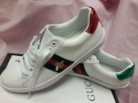 pair of white-and-red Adidas sneakers Los Angeles, 91402