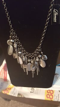 silver-colored necklace with clear gemstones CHANNELVIEW