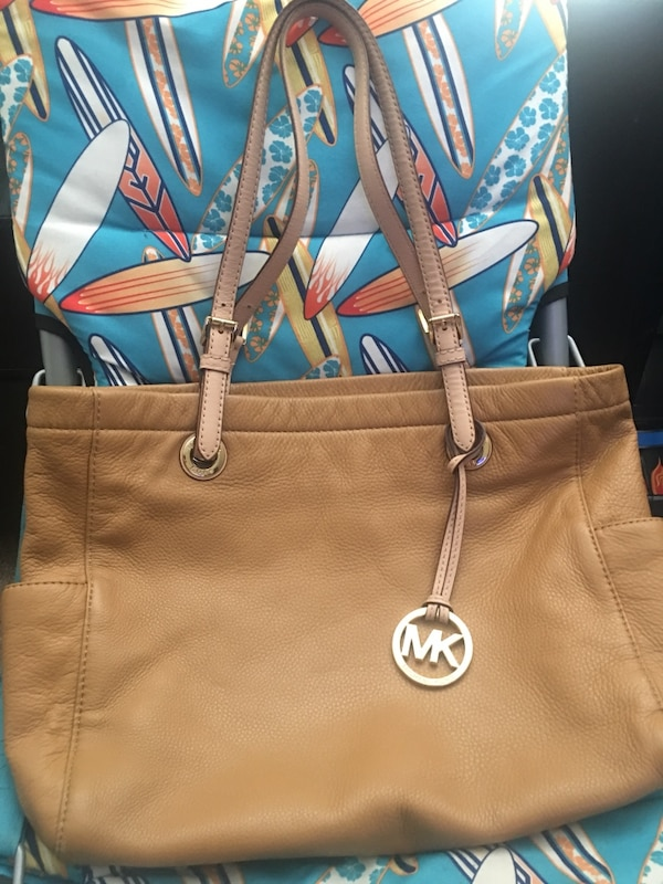 Mk authentic,some wear of the bag,but guc.