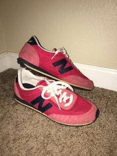Pair of pink-black-white-and-beige New Balance low top sneakers