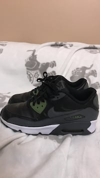 Pair of gray/black/olive nike air max shoes
