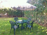 round black metal patio table with four chairs set Newmarket, L3Y 4M7