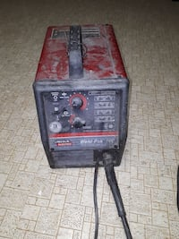 black and red Lincoln Electric welding machine