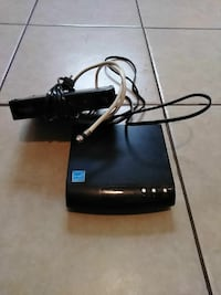 black and blue corded device TV converter's box's