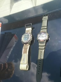 two assorted digital watches