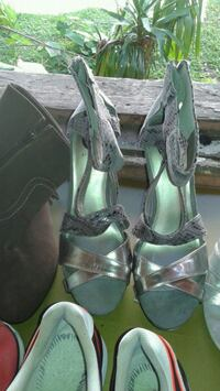 pair of green leather open-toe heeled sandals null