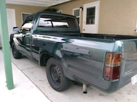 Green single cab pickup truck Oceanside, 92058
