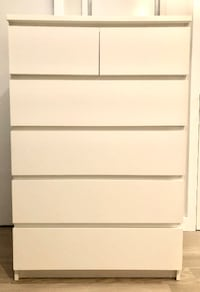 white wooden 5-drawer tallboy dresser null