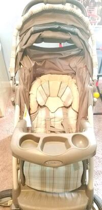 baby's brown and white stroller  Bristow