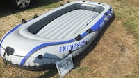 grey and blue Excursion 5 inflatable boat Seabrook, 03874