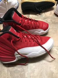 red-and-white Air Jordan 12 shoes