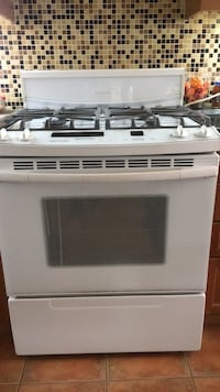 White and black induction range oven Toronto, M1B 6A3