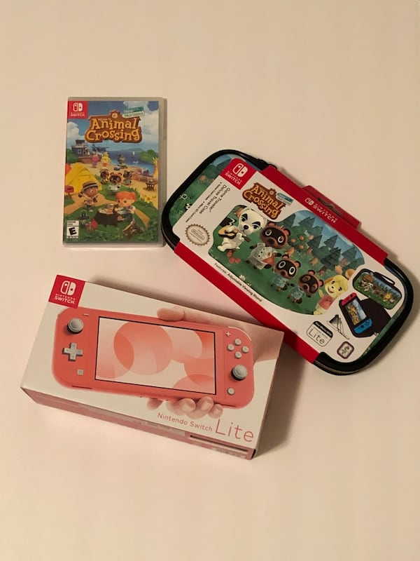 Sold Nintendo Switch Lite Coral Pink With Animal Crossing Game And Case In Tomball Letgo