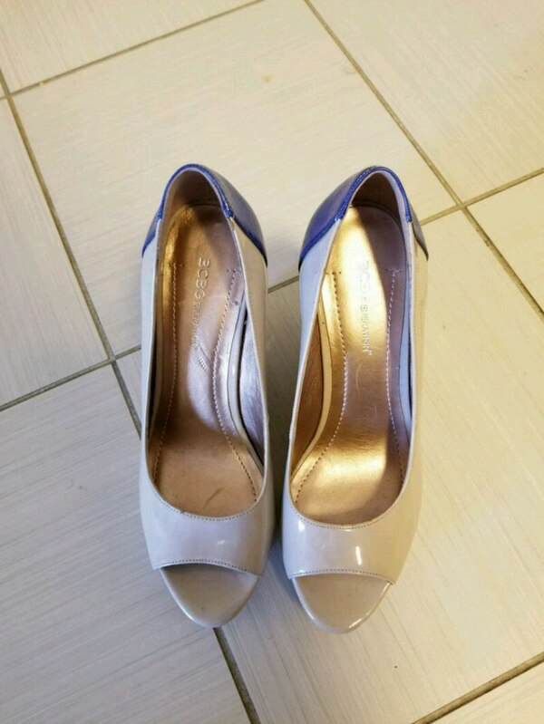 pair of gray leather peep-toe heeled shoes