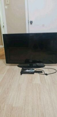 flat screen TV and black TV stand Baton Rouge, 70816