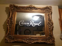 brown wooden framed Crown Royal mirror