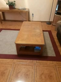 brown wooden coffee table with drawer
