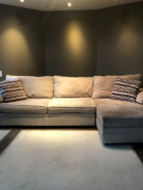 Two-piece Beige Sectional Couch b7c8360c-ccc5-4827-b8e4-9c4fd28fad06