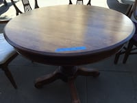 Round oak dinning table with 4 padded chairs excellent condition, heavy and durable.  Table 42 in width x 30 in height