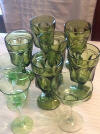 Four green glass candle holders New Tecumseth, L0G