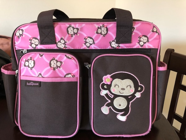 Pink and brown monkey diaper bag