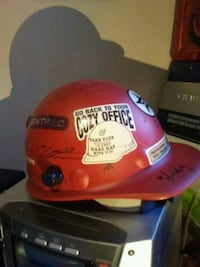 A cool helmet with multiple stickers and signature Vancouver, V6Z 1B3