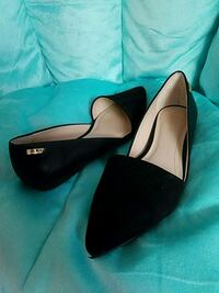 pair of black leather pointed-toe flat shoes Bozeman, 59715