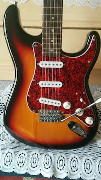 red and brown electric guitar 757 km
