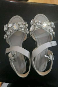 pair of white leather sandals Toronto, M3C 2J1