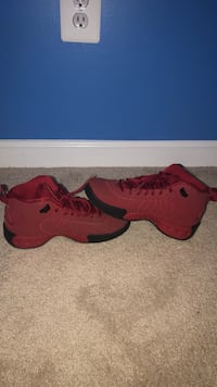 pair of red Nike basketball shoes Bristow, 20136