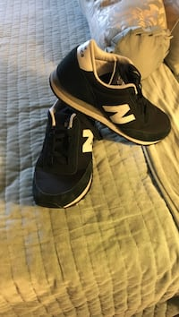 pair of black-and-white Nike sneakers Revere, 02151