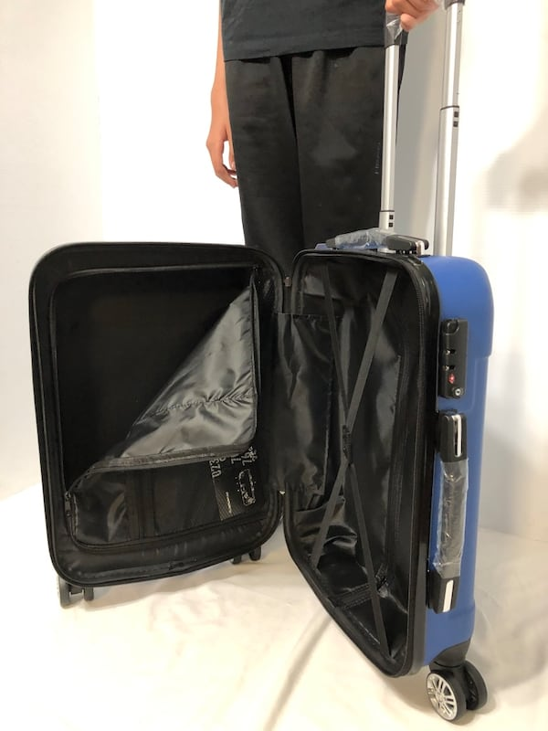 CARRY-ON LIGHTWEIGHT SPINNER LUGGAGE 58d30e71-e79b-4376-8558-c5e9ba7a4b16