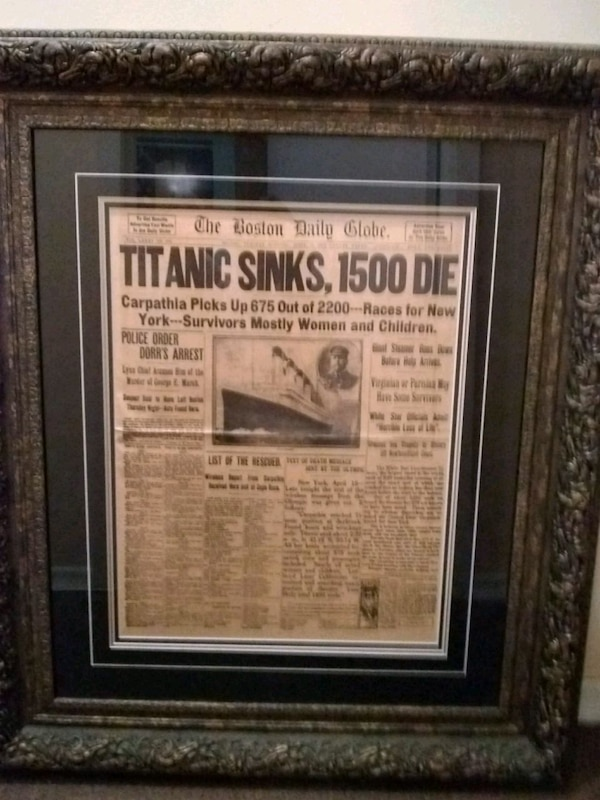 Used Titanic Sinks newspaper wall decor and black wooden frame for ...