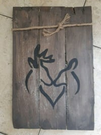 brown and black wooden wall decor