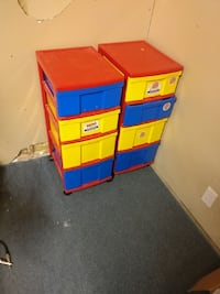 two red, yellow, and blue plastic 4-drawer chests