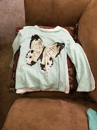 teal and brown butterfly-printed long-sleeved shirt