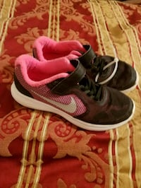 pair of black-and-white Nike running shoes Canton, 30114
