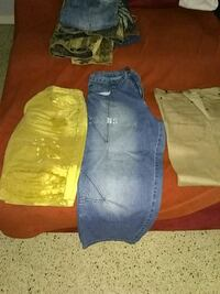 three blue, green, and brown denim jeans Lehigh Acres, 33936