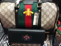 monogrammed beige and black Gucci tote bag and long wallet